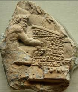 Satyr working at a wine press of wicker-work mats (1st century AD relief).