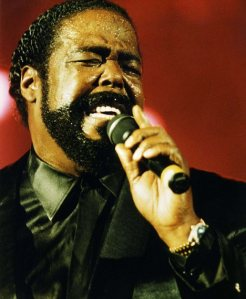 SOUL SINGER, BARRY WHITE, PICTURED SINGING DURING CONCERT.